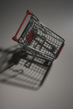 Shade from empty shopping cart with the red handle. Stock Photo - 8153372