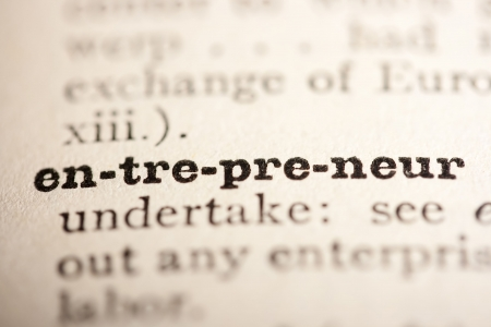 definition define: Word entrepreneur from the old dictionary, a close up.