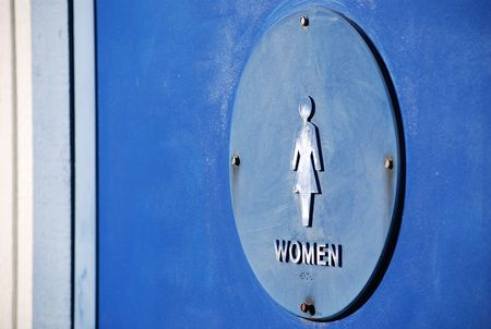 public figure: Pointer to the door of a public toilet with a female figure, inscription and embossed symbol for the blind.