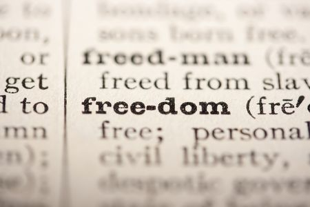 pronounce: Word freedom from the old dictionary, a close up. Stock Photo