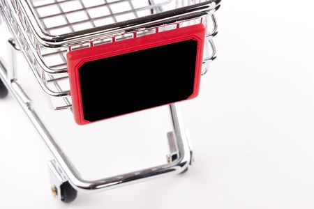 Empty shopping cart with the red handle on a white background. Stock Photo - 8213445