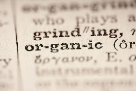 pronounce: Word organic from the old dictionary, a close up. Stock Photo