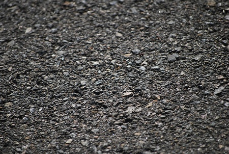 Asphalt - pavement as a background for the firms involved in construction and decoration works. Stock Photo