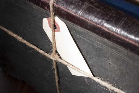 archival: Archival documents in a book-depository are tied up by a cord.