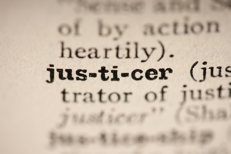 pronounce: Word justicer from the old dictionary, a close up.