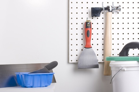 Different tools used for wall plastering and home improvement.