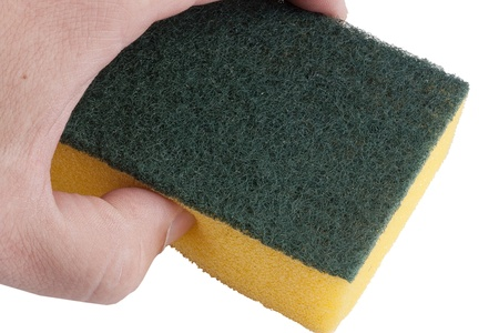 Yellow synthetic sponge for cleaning the mens hand.