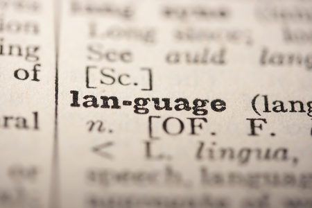pronounce: Word language from the old dictionary, a close up. Stock Photo