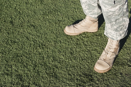 army boots: Soldier in camouflage pants and army boots. Stock Photo