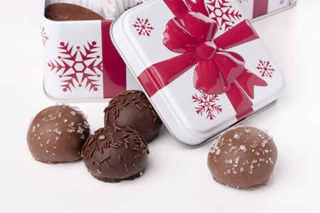 box of chocolates: Truffle candy coated chocolate with decorative powdered for the occasion.