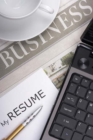 Category newspaper about the business with items related to job search: resume, laptop, etc. Stock Photo