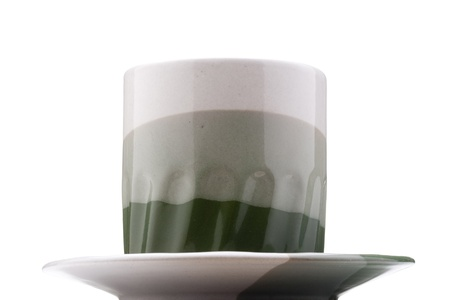 Ceramic mug and saucer with greyish green for hot drinks.