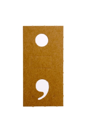 Cardboard stencil letter point and comma for the replication of the letters and make words. photo