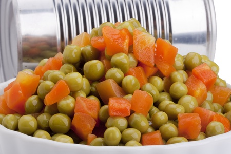 canned peas: Canned peas and carrots from the tin. Stock Photo