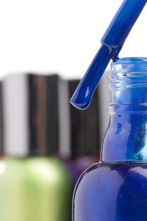 nail polish bottle: Open blue nail polish bottle with a brush. Stock Photo