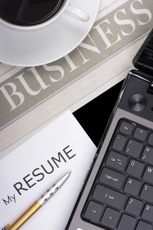 Category newspaper about the business with items related to job search: resume, laptop, etc. photo
