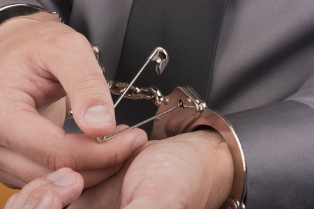 arrestment: Who was arrested trying to break free from the handcuffs with the pin.