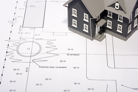 House model on a plan of a house construction. Stock Photo - 8748207