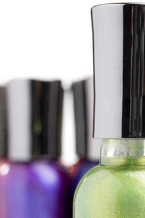 nail polish bottle: Open green nail polish bottle on a white background. Stock Photo