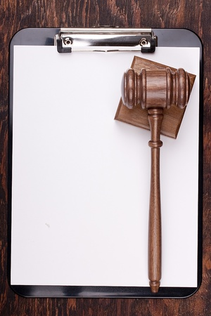 Wooden hammer used in court and in auctions. Add your text to the background. photo
