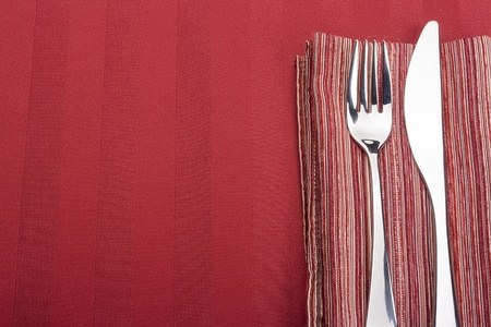 Knife and fork on a napkin as a dining room serving. photo