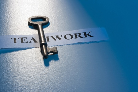 teamwork together: A key laying on a piece of paper with the word