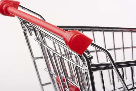 Empty shopping cart with the red handle on a white background. Stock Photo - 8748796
