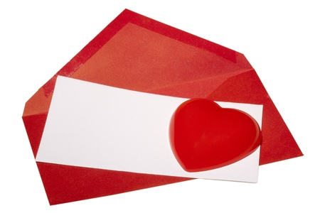 Red heart laying next to a red envelope with white paper on a white background. Stock Photo - 8748859