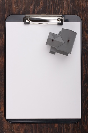 House model on a clipboard with white paper. Add your text to the paper. Stock Photo - 8748863