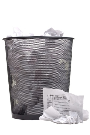 Crumpled form 1040 for filing tax returns in the U.S.. Stock Photo