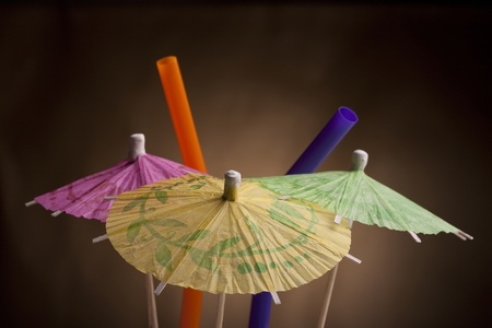 Paper umbrella and tubule to decorate the glasses with a cocktail. Stock Photo - 8752357