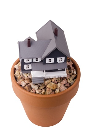simulator: Model home on a small stone gravel in a clay flower pot. Stock Photo