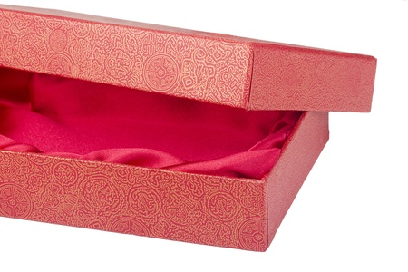 Gift box with a red inner liner of the fabric on a white background. photo