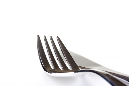 Knife and fork on a white background - tableware. photo