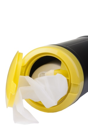 Napkin for cleaning in a plastic container with a white background. photo