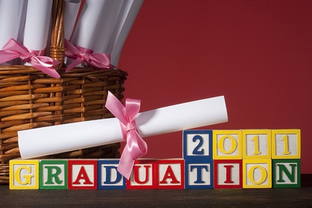 Diploma tied with a ribbon, the text of the wooden blocks  Stock Photo - 8860322