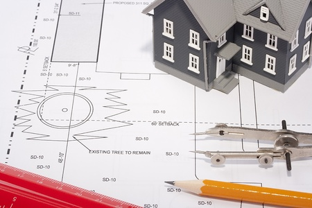 House model and drafting tools on a construction plan. Stock Photo - 8860315