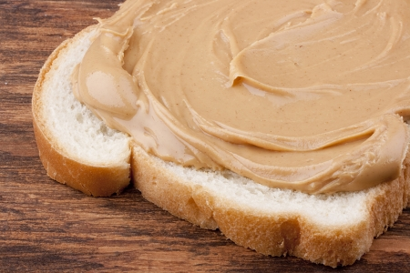 peanuts: Bread is smeared Peanut butter - a component for a sweet sandwich.