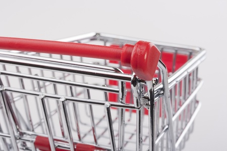 Empty shopping cart with the red handle on a white background. Stock Photo - 8970678