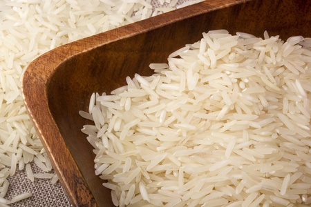 Close-up of white rice in a brown plate.