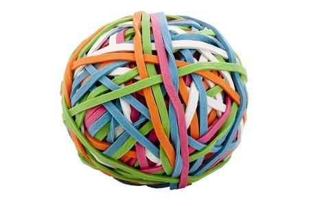 goma: Anillos de goma de diferentes colores reunieron para almacenamiento f�cil en un recipiente. Foto de archivo