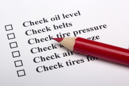 inspection: A checklist for vehicle safety with a red pencil.