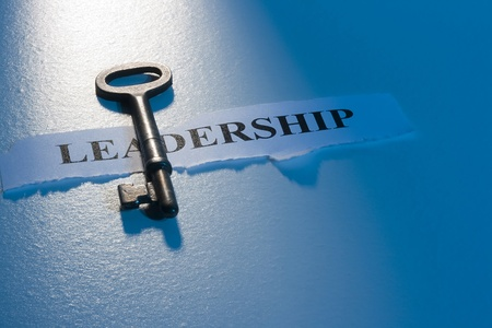 successful leadership: A key laying on a piece of paper with the word