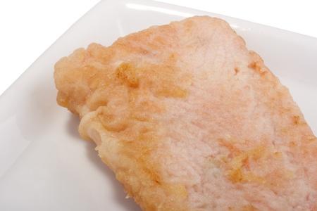 Serve grilled tuna on white ceramic plate.