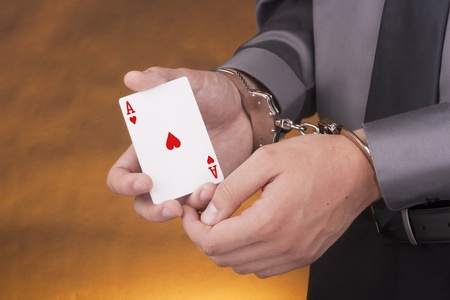 sequestration: Arrest card sharper, her hands handcuffed in one of the hands of an ace.