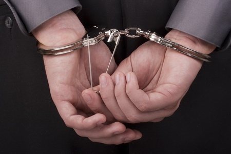 sequestration: Arrested trying to rid themselves from the handcuffs with the pin.