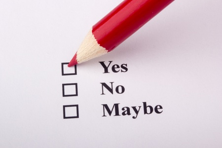 maybe: A red pencil checking the yes box on an opinion poll.
