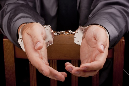 Arrest, arrested a man in handcuffs during the interrogation. Stock Photo - 9129300