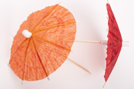 Paper umbrellas to decorate the glasses with a cocktail. photo