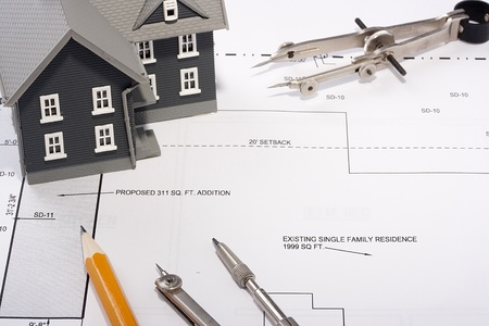 House model and drafting tools on a construction plan. Stock Photo - 9171639